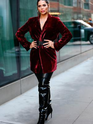 Nuelle Alves is seen wearing a red coat, black belt, black pants and black thigh high heels outside of the Naeem Khan show during New York Fashion Week on February 11, 2020 in New York City. (Photo by Donell Woodson/Getty Images)