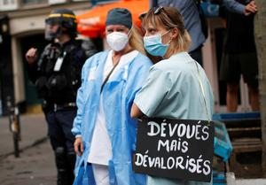 Masked crusaders: French health workers attend a protest on Bastille Day in Paris, as part of a nationwide day of actions in the wake of the coronavirus disease crisis, in France. Photo: Reuters
