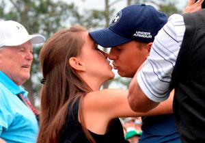 Jordan Spieth of the US kisses girlfriend, Annie Verret, as he celebrates winning the 79th Masters Golf Tournament at Augusta National Golf Club