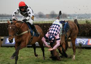 Smart Freddy and his jockey Nico de Boinville take full advantage of the final-fence fall of Jamie Moore from Leo Luna to land yesterday's opening novice chase at Doncaster