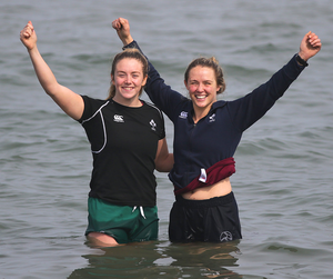 Ashleigh Baxter and Stacey Flood go for a paddle at Dun Laoghaire