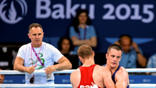 16 June 2015; Darren O'Neill, Ireland, right, and Ionut Jitaru, Romania, following their Men's Boxing Heavy 91kg Round of 32 bout. 2015 European Games, Crystal Hall, Baku, Azerbaijan. Picture credit: Stephen McCarthy / SPORTSFILE