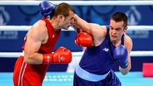 16 June 2015; Darren O'Neill, Ireland, right, exchanges punches with Ionut Jitaru, Romania, during their Men's Boxing Heavy 91kg Round of 32 bout. 2015 European Games, Crystal Hall, Baku, Azerbaijan. Picture credit: Stephen McCarthy / SPORTSFILE