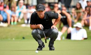 Paul Casey lines up a putt on the second green on the opening round of the Tour Championship at East Lake GC in Atlanta