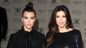 Kim and Kourtney Kardashian came to blows in the latest trailer for the family's reality TV show. (Ian West/PA)
