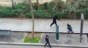 Gunmen flee after shooting a wounded police officer (right) on the ground at point-blank range, outside the offices of French satirical newspaper Charlie Hebdo in Paris. Reuters/Handout via Reuters TV