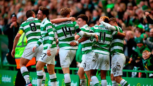 Celtic's Scott Sinclair celebrates scoring his side's second goal of the game with teammates during the Active Nation Scottish Cup, semi-final match at Celtic Park