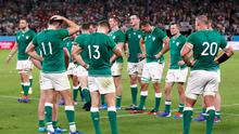 Ireland players look dejected after the match. Photo: Peter Cziborra/Reuters