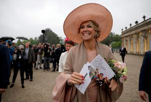 Queen Maxima of The Netherlands smiles as she is greeted by wellwishers in front of Sans Souci palace on May 22, 2019 in Potsdam near Berlin, northeastern Germany. (Photo by Christoph Soeder / dpa / AFP)