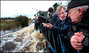 Taoiseach Enda Kenny chats with Cllr Tom Farrell Mayor of Athlone in Carrickobreen during the flooding