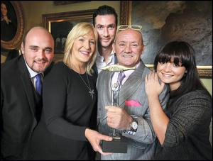 Brendan O'Carroll with his wife Jennifer, children Eric and Fiona and her husband Martin Delany (centre back) after he received the award. Photo: Steve Humphreys. Photo: Steve Humphreys