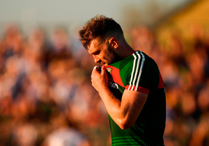 DOWN AND OUT: Aidan O'Shea of Mayo leaves the field after being sent off by referee David Gough for a second yellow card late into Saturday evening's qualifier clash at Newbridge. Photo by Piaras Ó Mídheach/Sportsfile