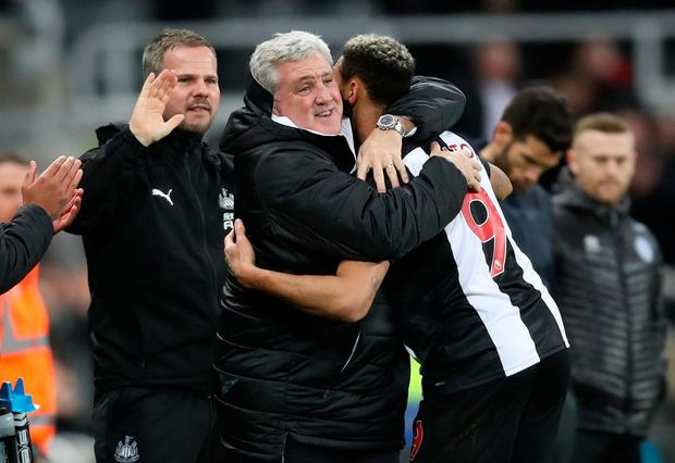 Newcastle United's Joelinton celebrates scoring his side's fourth goal of the game with manager Steve Bruce during the FA Cup third round replay match at St James' Park, Newcastle. Owen Humphreys/PA Wire.