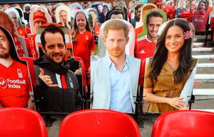 STIFF UPPER LIP: Harry and Meghan in effigy and in the stands at last week's Nottingham Forest vs Fulham game. Photo: PA