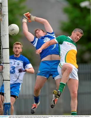 20 June 2015; Waterford goalkeeper Sean Barron drops the ball into the goal under pressure from Offaly's Niall Smith. GAA Football All-Ireland Senior Championship, Round 1A, Waterford v Offaly, Fraher Field, Dungarvan, Co. Waterford. Picture credit: Matt Browne / SPORTSFILE