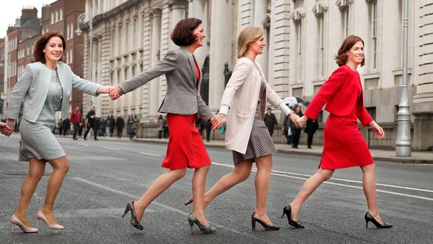 Fine Gael TDs, from left, Josepha Madigan, Kate O'Connell, Maria Bailey and Hildegarde Naughton making their way back to Government Buildings in Dublin after a FG International Womens' Day photo call. Photo: Gerry Mooney