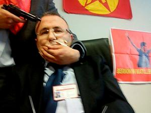 In this picture obtained from the Ilhas News Agency Turkish an alleged millitant from the Turkish Marxist-Leninist left wing organisation, the DHKP-C, holds a gun to the head of prosecutor Mehmet Selim Kiraz in Istanbul
