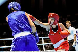 Katie Taylor, Ireland, right, exchanges punches with Yana Allekseevna, Azerbaijan, during their 60kg Light Weight Final. 2014 AIBA Elite Women's World Boxing Championships, Jeju, Korea. Picture credit: Paul Mohan / SPORTSFILE