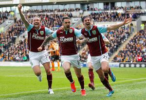 Danny Ings celebrates scoring Burnley's winning goal with Matthew Taylor (L) and George Boyd