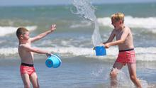 Brothers Luke and Josh Monaghan play in the water at Portmarnock Strand in Dublin  Photo: Damien Eagers