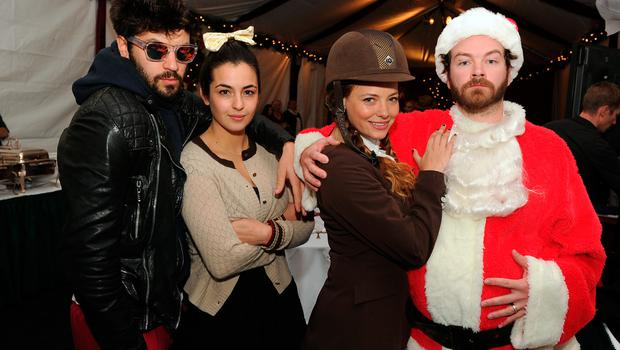 """(L-R) Jordan Masterson, Alanna Masterson, Bijou Phillips and Danny Masterson attend the Church of Scientology Celebrity Centre's 21st """"Christmas Stories"""" at the Church of Scientology Celebrity Centre on December 14, 2013 in Los Angeles, California. """"Christmas Stories"""" benefits the Hollywood Police Department's Youth Development Programs for underprivileged children.  (Photo by Kevin Winter/Getty Images)"""