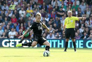 Burnley's Scott Arfield takes the penalty only for it to be saved by Crystal Palace's goalkeeper Julian Speroni