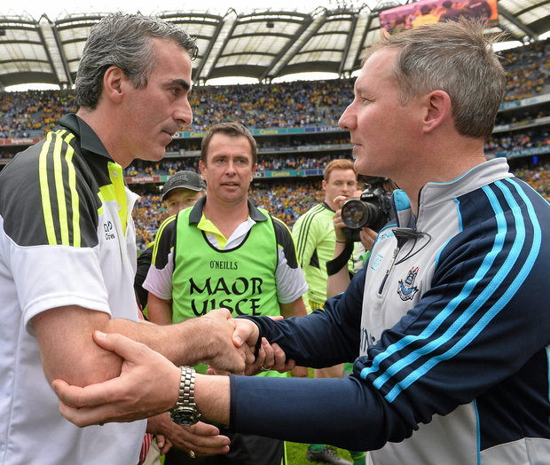 Jimmy McGuinness and Jim Gavin after Donegal's win over Dublin in the 2014 All-Ireland semi-final. Photo: David Maher / SPORTSFILE