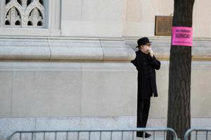 A guest stands outside of the funeral of comedienne Joan Rivers at Temple Emanu-El in New York September 7, 2014. REUTERS/Lucas Jackson