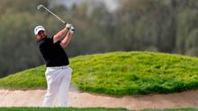 Shane Lowry of Ireland chips out of a bunker on the 6th hole during the round one of the Dubai Desert Classic golf tournament in Dubai, United Arab Emirates, Thursday, Jan. 24, 2019. (AP Photo/Neville Hopwood)
