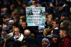 A Man City fan holds up a banner during the Barclays Premier League match between Manchester City and Chelsea