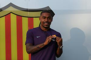 Barcelona's new Brazilian forward Malcom poses at the Camp Nou