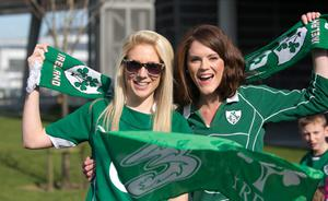 22/03/2015 Fans (L to r) Ruth Fitzgerald from Waterford & Ciara Pykett from Swords during the homecoming of 6 Nations Rugby champions Ireland at Dublin Airport. Photo:  Gareth Chaney Collins