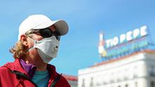 A woman wears a protective face mask as she stands at one of the main touristic landmarks Puerta del Sol in Madrid, Spain, March 9, 2020. REUTERS/Sergio Perez