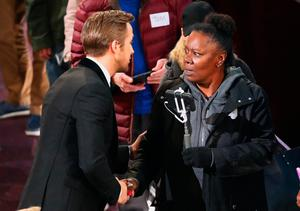A woman shakes hands with actor Ryan Gosling during a skit. REUTERS/Lucy Nicholson