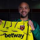Darren Randolph holds up the West Ham goalkeeper's shirt after signing a three-and-a-half year deal