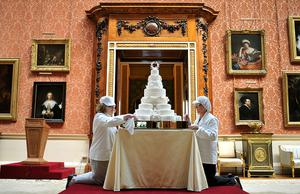 LONDON, ENGLAND - APRIL 29:  (L-R) Rachel Jane Eardley and Diane Pallett put the finishing touches to the Royal Wedding cake that Fiona Cairns and her team at Fiona Cairns Ltd of Leicestershire made for Prince William and Catherine Middleton in the Picture Gallery of Buckingham Palace on April 29, 2011 in central London, England. The marriage of Prince William, the second in line to the British throne, to Catherine Middleton is being held in London today. The Archbishop of Canterbury conducted the service which was attended by 1900 guests, including foreign Royal family members and heads of state. Thousands of well-wishers from around the world have also flocked to London to witness the spectacle and pageantry of the Royal Wedding and street parties are being held throughout the UK.  (John Stillwell-WPA Pool/Getty Images)