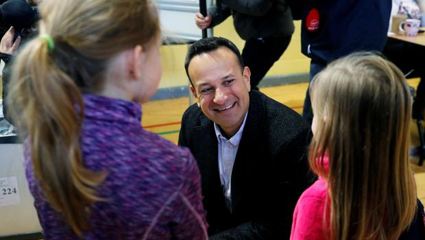 Leo Varadkar talks with children after casting his vote. REUTERS/Phil Noble