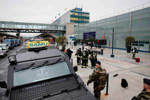 Military and emergency services outside Orly airport southern terminal after a shooting incident near Paris, France March 18, 2017.  REUTERS/Benoit Tessier