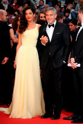 Amal Clooney and George Clooney pose for photographers upon arrival for the screening of the film Money Monster in Cannes.