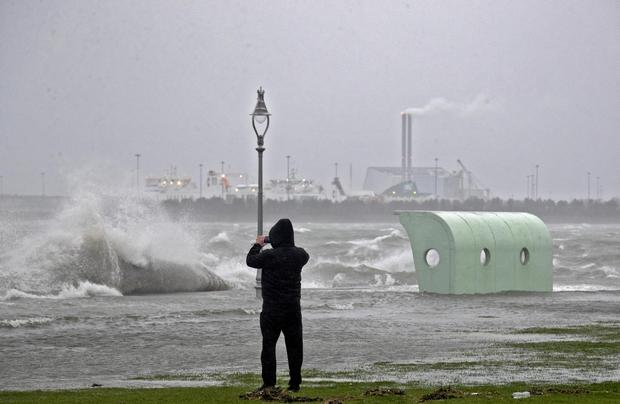 Waves crash over the seafront in Clontarf this afternoon during Storm Brendan Picture Colin Keegan, Collins Dublin