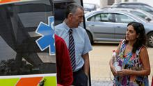 Brett (L) and Naghemeh King, parents of 5-year-old Ashya King (not pictured), wait next to an ambulance car at the Proton Therapy Center in Prague September 9, 2014.  REUTERS/David W Cerny