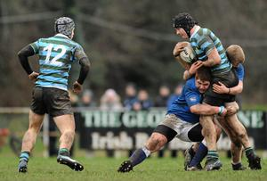 Donal Smyth, St Gerard's School, supported by team-mate Rob Toal Lennon, 12, is tackled by Conor Whelan, bottom, and Jordan Finnegan, St Mary's College