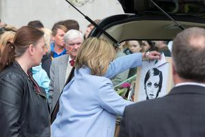 Ana Hick's mother Elga places a picture in the back of the hearse at her daughters funeral mass in the Church of the Assumption, Dalkey  Pic:Mark Condren 20.5.2015
