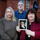 Deirdre Brennan (right) pictured alongside her brother Niall Brennan and sister Emma Brennan holds a photograph of their father John Brennan from Portlaoise outside the Coroners Court in Dublin Photo: Steve Humphreys