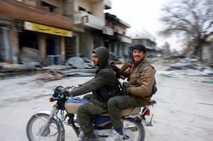 Fighters of the Kurdish People's Protection Units (YPG) patrol on a motorcycle in the streets of the northern Syrian town of Kobani January 28, 2015.  REUTERS/Osman Orsal