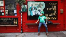 A man dressed up for St Patrick's Day outside Temple Bar in Dublin. AP Photo/Peter Morrison