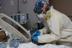 Disease: A Covid-19 patient is cared for in an intensive care unit. Photo by Go Nakamura/Getty Images