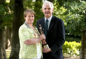 Elma and Fionnbar Walsh with Donal's People of the Year award.