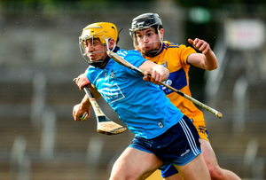 Dublin's Daire Gray is tackled by Tony Kelly of Clare. Photo by Ray McManus/Sportsfile