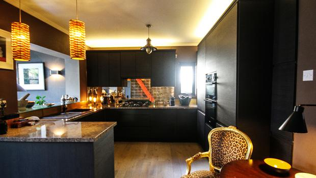 Gitte Trench's Country Cottage: The dark kitchen came as an unexpected surprise to the judges who credited Gitte's choice of copper-look wallpaper Photo credit: RTE